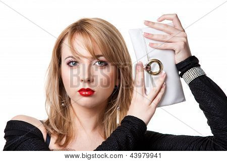 woman with red lips holding white purse