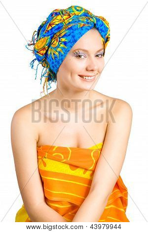 beautiful smiling girl with in colorful clothes and hat