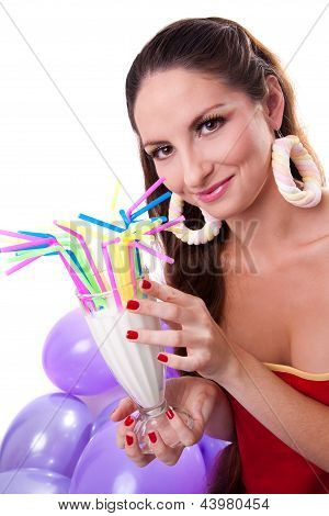 beautiful girl with candy earrings drinking cocktail