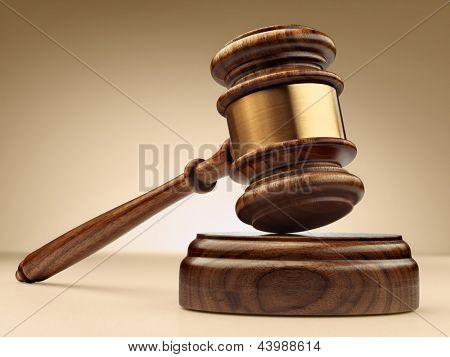 A wooden judge gavel and soundboard on brown white background in perspective