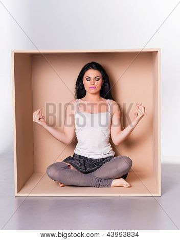 Meditating Woman Trapped In Box Concept
