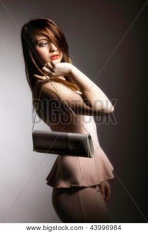 Beautiful Young Woman With Handbag.