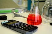 Red liquid in beaker on the table in the laboratory soft focus poster