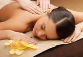picture of woman in spa salon lying on the massage desk poster