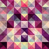 Seamless textured bright multicolored pattern of triangles with an optical effect poster
