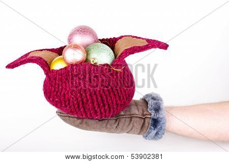 Knitted Hat With Christmas Decorations On Hand