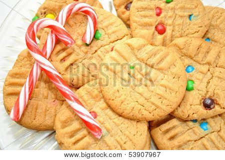 Two Peppermint Candy Canes on Peanutbutter Cookies