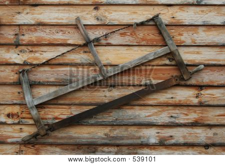 An Old Saw Hangs On The Wall