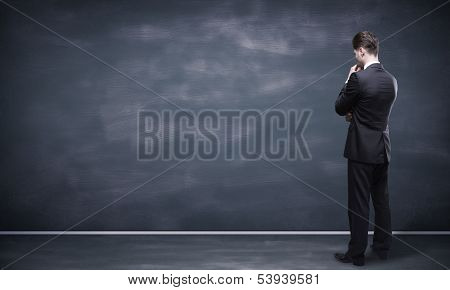 Man Looking At Blackboard