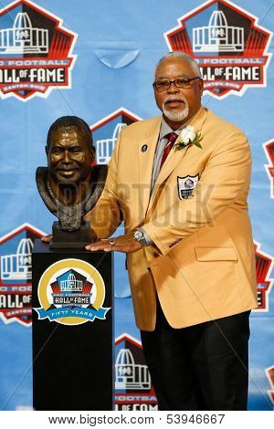 CANTON, OH-AUG 3: Former defender Curley Culp poses with his bust during the NFL Class of 2013 Enshrinement Ceremony at Fawcett Stadium on August 3, 2013 in Canton, Ohio.