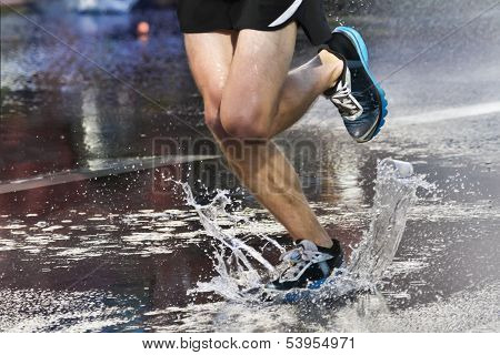 Marathon Runner Crossing Puddle