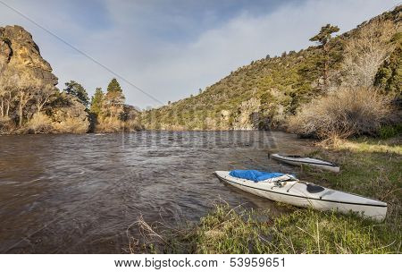 two decked expedition canoes on North Platte River in Wyoming below Bennet Peak campground near Saratoga
