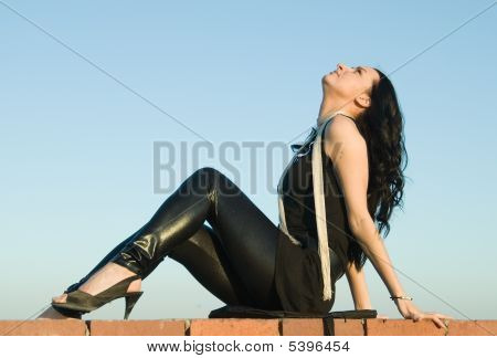 Sitting Girl On Roof