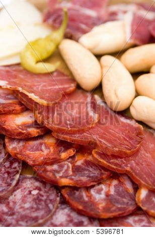 Appetizer Platter Of Cold Meats, Cheese Slices And Green Chilli