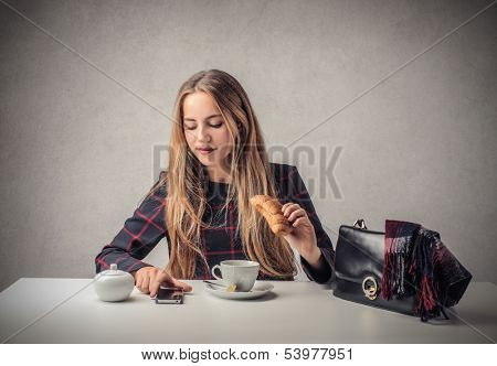 beautiful woman having breakfast before go to work