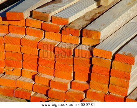 Pile of 2x4 Construction Lumber Studs