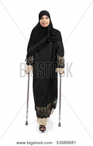 Arab Woman Walking With Crutches