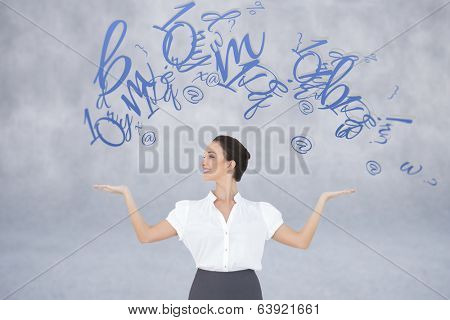 Happy elegant businesswoman posing with letters against grey wall