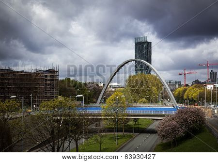Hulme arch bridge and beetham tower viewed from Princess road which leads into Manchester city centre poster
