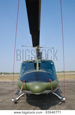 Helicopter Standing On Landing Strip In Airfield