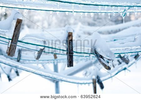 Clothes Pins On Frozen Laundry Line