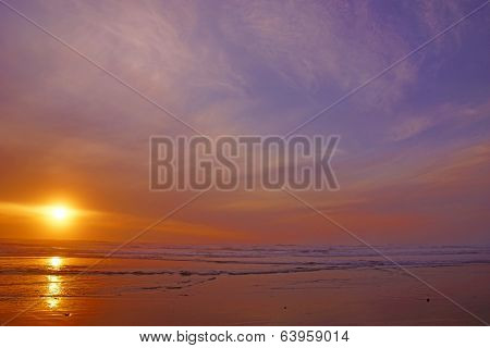 Dramatic Ocean Sunset With Clouds And Blue Sky