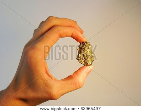 Hand Holding Gold Nugget