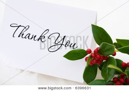 A thank you card with holly and berries on a white fur background thank you card poster