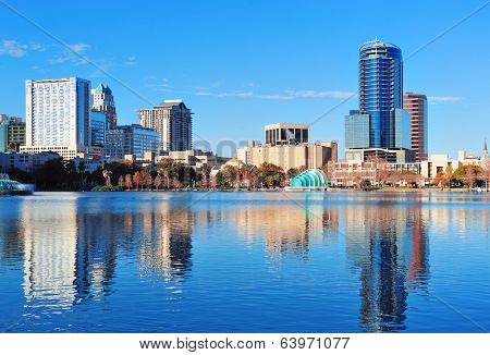 Orlando Lake Eola in the morning with urban skyscrapers and clear blue sky.