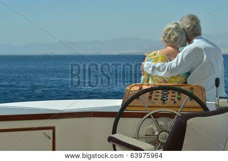 Senior couple having boat ride