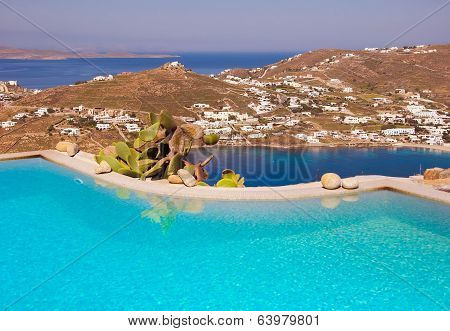 Blue Pool On A Background Of Sky And Sea In Greece.