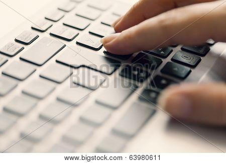 Woman Typing On Keypad