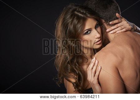 Sexy young couple embracing