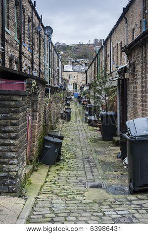 litter bins on a cobbled street