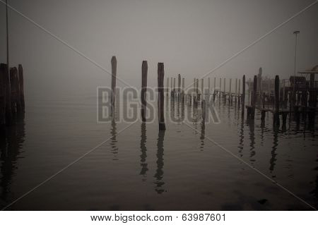 Fishing village harbour in the mist