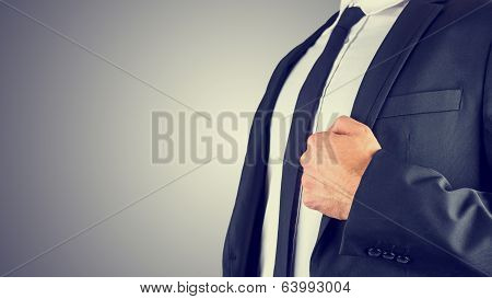 Businessman Holding The Lapel Of His Jacket