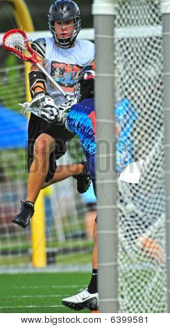 Chumash lacrosse jumping for the shot