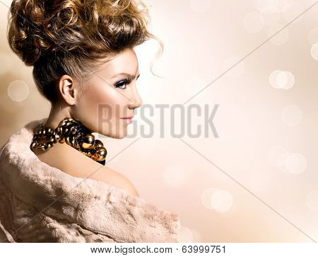 Glamour lady portrait in luxury fur coat. Beautiful model girl with perfect fashion makeup and hairstyle. Trendy accessories.
