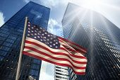 USA national flag against low angle view of skyscrapers poster