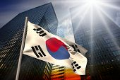 South korea national flag against low angle view of skyscrapers at sunset poster
