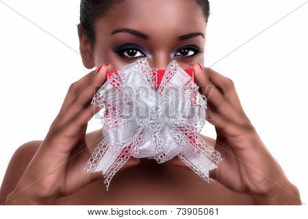 African American woman with Christmas or Valentine's day gift