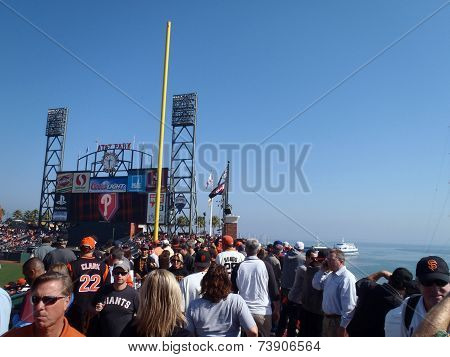 Crowd Of Baseball Fans Walks Along The Arcade Deck During Game Three Of The Nlcs 2010