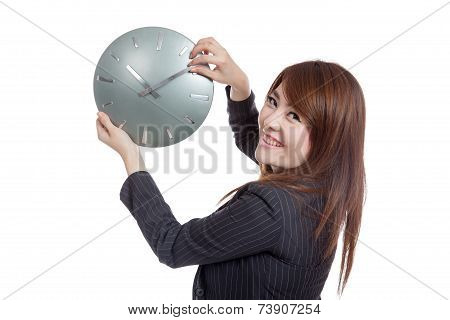 Asian Businesswoman Move A Clock Hand And Turn Back