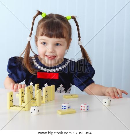 Smiling Girl Sitting At Table