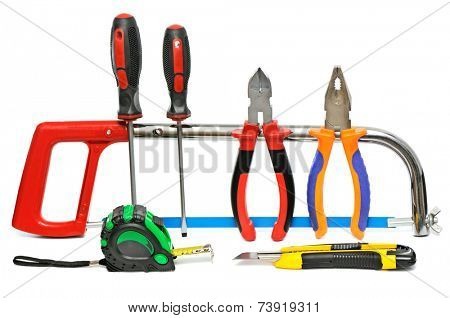 collection of hand tools on white background