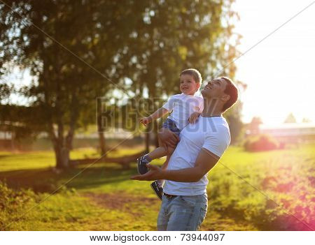 Happy Father And Son Having Fun, Enjoying Sunny Summer Day
