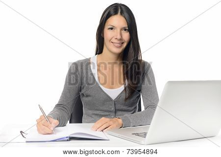 Smiling Young Woman Working At A Desk