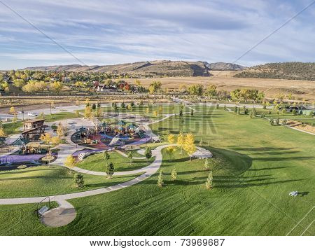 aerial view of park and playground at foothills of Rocky Mountains in Fort Collins, Colorado poster