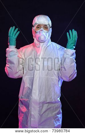 Man in Hazmat suit, protective gloves and goggles over dark background