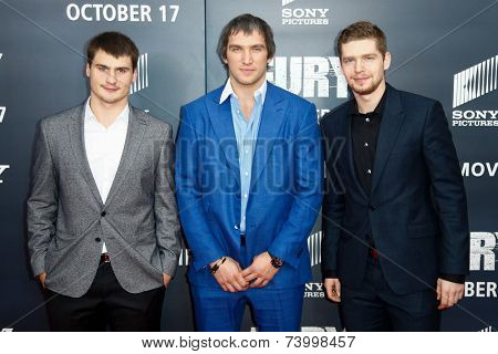 WASHINGTON, DC-OCT 15: NHL players Dmitry Orlov (L), Alex Ovechkin (C) & Evgeny Kuznetsov of the Washington Capitals at